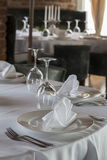 Restaurant table with white tablecloth Stock Image
