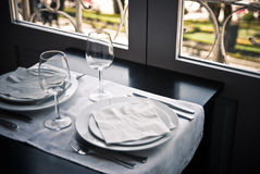 Restaurant table and windows stock photo