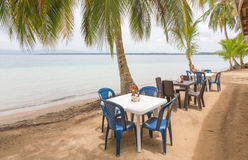 Restaurant tables on the beach Royalty Free Stock Photo