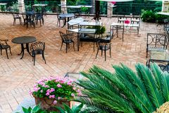 Restaurant tables and chairs on a brick patio Royalty Free Stock Photos