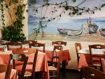 Restaurant tables and chairs. Restaurant tables with tablecloths and cutlery Royalty Free Stock Photography