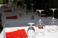 Restaurant tables with crystal stemware Royalty Free Stock Photos