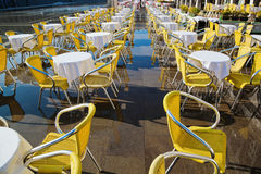 Restaurant tables on the flooded St. Mark's Square Stock Photo