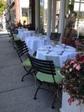 Restaurant. Tables flowers street outside Royalty Free Stock Photos