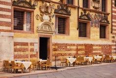 Restaurant tables in front of Palazzo Ragione in Piazza dei Signori in Verona Royalty Free Stock Photo