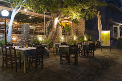 Restaurant tables in Greek beach Stock Photography