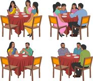 Restaurant tables with indian people. Wearing traditional clothes Royalty Free Stock Photos