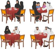Restaurant tables with muslim people. Wearing traditional clothes Royalty Free Stock Images