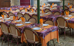 Restaurant tables. Old fashioned, colorful restaurant tables in France Royalty Free Stock Photography