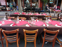 Restaurant Tables Outside for Dining Al Fresco. One of the town`s main thoroughfares, Park Avenue, is closed during the annual Summer Kick-Off/Cruisin' on the Royalty Free Stock Photos