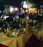 Restaurant Tables Outside for Dining Al Fresco. One of the town`s main thoroughfares, Park Avenue, is closed during the annual Summer Kick-Off/Cruisin' on the Royalty Free Stock Image