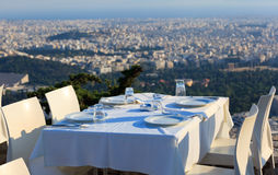 Restaurant tables with panoramic view of athens town Stock Image