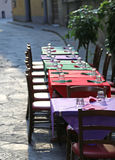 Restaurant with the tables prepared along the pedestrian street Stock Image