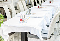 Restaurant tables ready to serve guests Royalty Free Stock Images