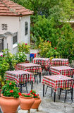 Restaurant tables on street terrace Stock Images