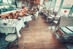 Restaurant with tables and tableware Stock Photo