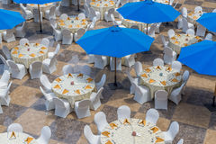 Restaurant Tables and Umbrellas Stock Image