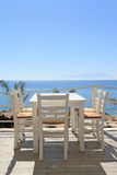 Restaurant - tavern by the sea. Typical greek tavern - cafe on balcony, by the Aegean sea Stock Photo