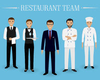 Restaurant team concept. Group of characters standing together: manager, chef, cook and two waiters in uniform. Stock Photos