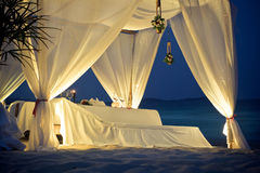 Restaurant Tent on Beach. White restaurant tent on the beach at night Stock Image