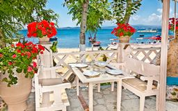 Restaurant terace in Ouranoupolis ,Greece . ATHOS, GREECE-MAY 25, 2014:Restaurant terace in Ouranoupolis one of the most attractive, but perhaps lesser known royalty free stock images