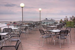 Restaurant terrace. Beautiful restaurant terrace with sea views at sunset royalty free stock photos