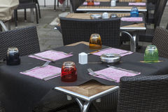 Restaurant Terrace. Image of a beautiful and colorful Venetian street restaurant terrace with rattan chairs Royalty Free Stock Images