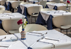 Restaurant Terrace. Image of a beautiful and elegant Venetian street restaurant terrace with rattan chairs Stock Photo