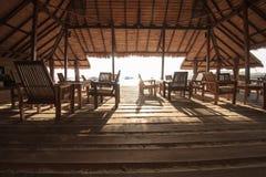 A restaurant terrace on beach front Stock Photos