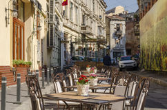 Restaurant terrace in Bucharest old town. Restaurant terrace with tables outside in the old town of Bucharest on April 14, 2014 in Bucharest, Romania Royalty Free Stock Photography