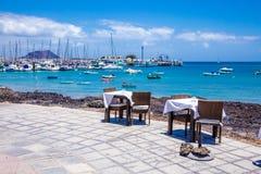 Restaurant terrace in Corralejo port Stock Photography