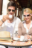 Restaurant terrace elegant couple  drink coffee Stock Photos