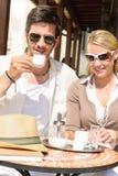 Restaurant terrace elegant couple  drink coffee. Italian restaurant terrace elegant couple sitting drink coffee summer day Stock Photos