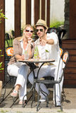 Restaurant terrace elegant couple  drink sunny day. Italian restaurant terrace elegant couple sitting drink water summer day Stock Photography