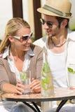Restaurant terrace elegant couple  drink sunny day. Italian restaurant terrace elegant couple sitting drink water summer day Stock Photos