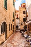 Restaurant Terrace in Kotor. An Outdoor Restaurant Terrace in a Narrow Alley in Kotor, Montenegro Stock Image