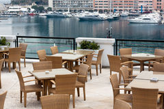 Restaurant terrace overlooking yacht harbor. In french riviera Stock Photography
