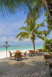 Restaurant on tropical beach next blue ocean Royalty Free Stock Photography