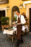 Restaurant in a typical  streets of Roma Stock Image