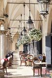 Restaurant under the arches of Cloth Hall, Krakow, Poland Royalty Free Stock Photo