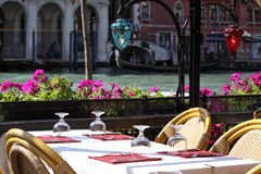 Restaurant in Venice. Along the Canal Grande with gondola Stock Photos