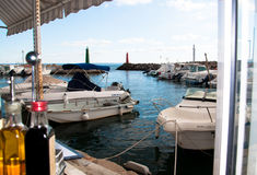 Restaurant view in Molinar Mallorca. Restaurant view in Molinar, Palma de Mallorca. View from the restaurant to the small marina on a tourist free winter day in Royalty Free Stock Images