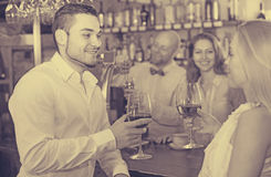 Restaurant visitors drinking wine Royalty Free Stock Images