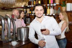 Restaurant visitors drinking wine Stock Image