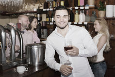 Restaurant visitors drinking wine Stock Images