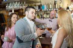 Restaurant visitors drinking wine Stock Photography
