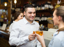 Restaurant visitors waiting for table. Smiling restaurant visitors waiting for table and drinking wine at bar royalty free stock images