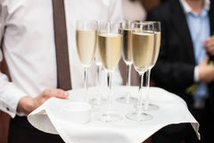 Restaurant waiter brings people and alcohol champagne Stock Photography