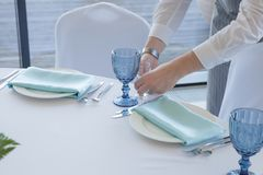 Restaurant waiter serves a table for a wedding celebration stock image