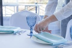 Restaurant waiter serves a table for a wedding celebration, close-up stock images